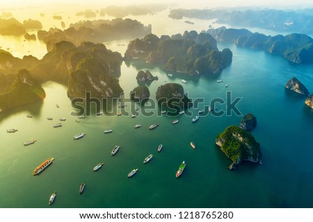 Aerial view floating fishing village and rock island, Halong Bay, Vietnam, Southeast Asia. UNESCO World Heritage Site. Junk boat cruise to Ha Long Bay. Popular landmark, famous destination of Vietnam  Royalty-Free Stock Photo #1218765280