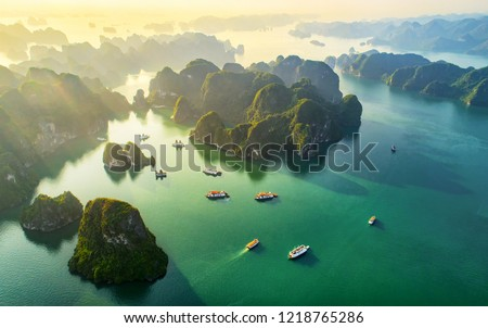 Aerial view floating fishing village and rock island, Halong Bay, Vietnam, Southeast Asia. UNESCO World Heritage Site. Junk boat cruise to Ha Long Bay. Popular landmark, famous destination of Vietnam  Royalty-Free Stock Photo #1218765286