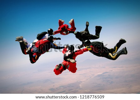 Skydiving teamwork formation #1218776509