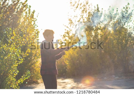young man have fun with smoke fire cracker #1218780484