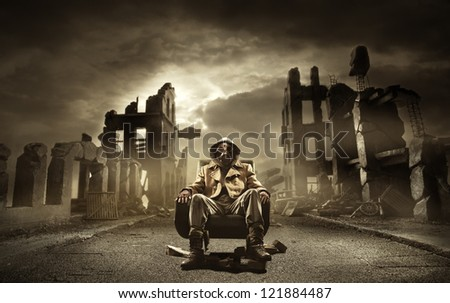 Post apocalyptic survivor in gas mask, destroyed city in the background Royalty-Free Stock Photo #121884487