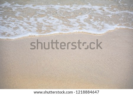 Soft wave of blue ocean on sandy beach.  Empty sea and beach background with copy space. Nature background.  #1218884647