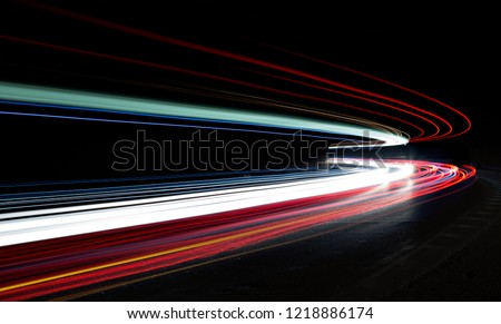 Truck light trails in tunnel. Art image . Long exposure photo taken in a tunnel  #1218886174