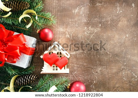 Christmas composition. Christmas gifts, fir tree branches and red ball on brown background. Flat lay, top view, copy space #1218922804