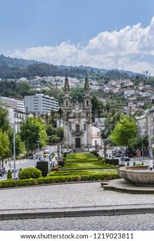 GUIMARAES, PORTUGAL - APRIL 19, 2017: Guimaraes Largo da Republica do Brasil - Central Square with gardens. Guimaraes City center is a UNESCO World Heritage Site. #1219023811