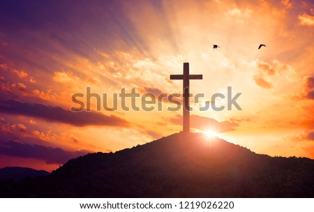 Christmas concept: Crucifixion Of Jesus Christ Cross At Sunset #1219026220