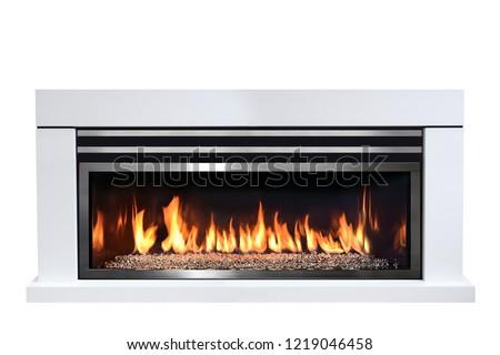 Burning gas fireplace isolated on white background. #1219046458