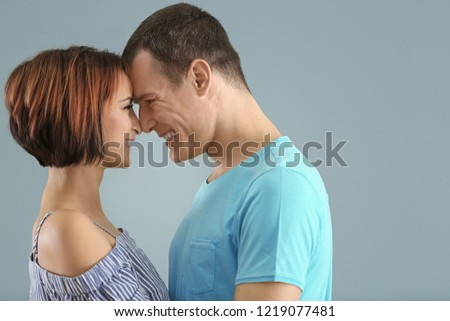 Portrait of cute loving couple on color background #1219077481