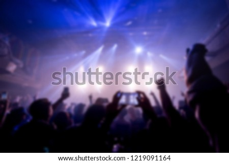 Effects blur Concert, disco dj party. People with hands up having fun paper flap  #1219091164