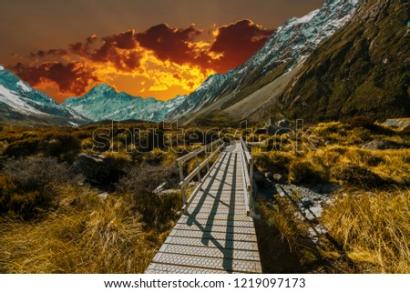 Pedestrian walkway with sunset background #1219097173