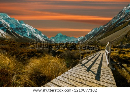 Pedestrian walkway with sunset background #1219097182