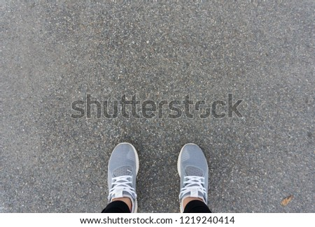 Runing shoes of woman standing on the road. #1219240414