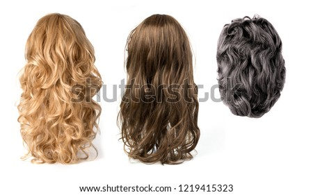 long curly blond ,black and brown hair wigs isolated on white background Royalty-Free Stock Photo #1219415323