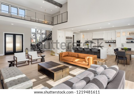 Living Room in Open Concept New Luxury Home with View of Entry, Kitchen, and Second Floor.  #1219481611