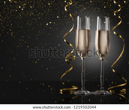 Happy 2019! Holiday champagne glasses and golden decorations, copy space #1219502044