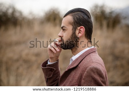 Male smoking a cigarette #1219518886