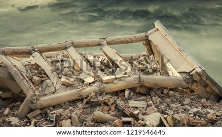 View on a collapsed concrete industrial building with dark dramatic sky above. Damaged house. #1219546645