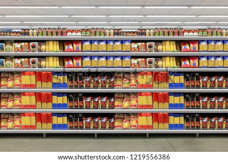 Pasta packing on a shelf in a supermarket. is suitable for presenting new packaging among many others. #1219556386