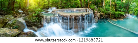 Panoramic beautiful deep forest waterfall in Thailand Royalty-Free Stock Photo #1219683721