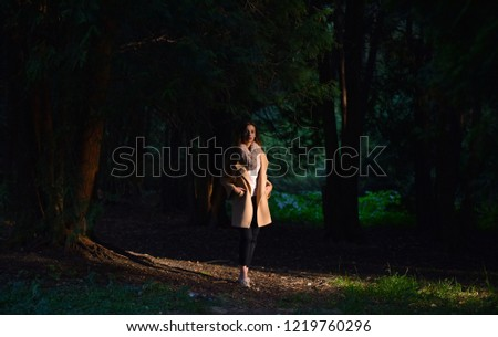 portrait of a girl in autumn Park #1219760296