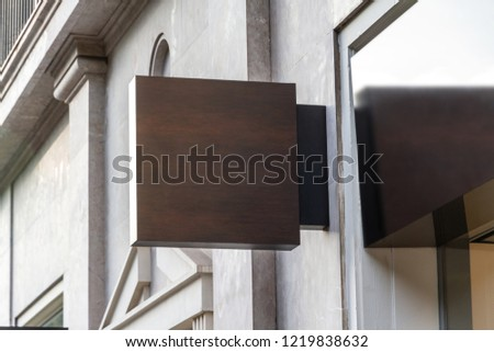 Store brand sign mockup in street on marble wall