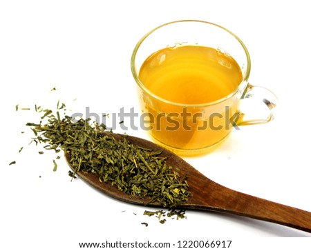 cup of green tea and spoon with tea #1220066917