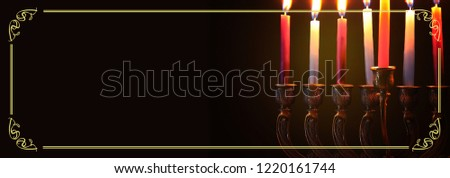 image of jewish holiday Hanukkah background with menorah (traditional candelabra) and candles #1220161744