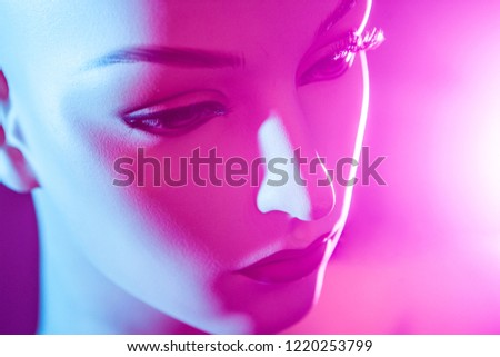 Mannequin in neon light. Female robot Artificial Intelligence. Portrait of a woman. Mannequin in pink color. #1220253799