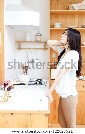 attractive asian woman in the kitchen #122027521