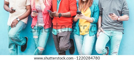 Group of friends watching smart mobile phones - Teenagers addiction to new technology trends - Concept of youth, tech, social and friendship - Main focus on center hands  #1220284780