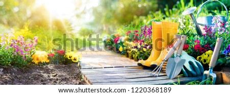 Gardening Tools With Green Flower Work #1220368189