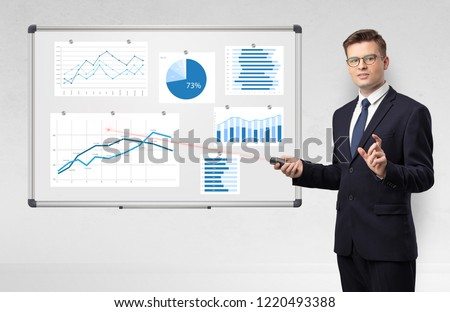 Handsome businessman presenting report on white board with laser pointer  #1220493388