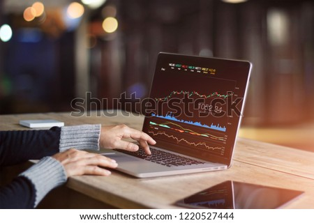 Businessman using laptop for analyzing data stock market, forex trading graph, stock exchange trading online, financial investment concept. All on laptop screen are designed up.  #1220527444