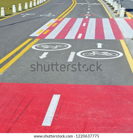 Ukraine, Polyanytsya - October 16, 2018 : Road section with road markings that regulate the movement of pedestrians and cyclists. #1220637775