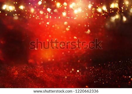 Red, black and gold glitter lights background. defocused #1220662336