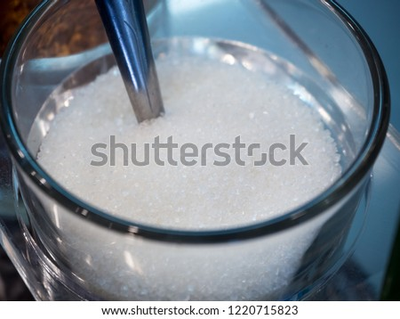 Sugar in a transparent glass With a spoon. #1220715823