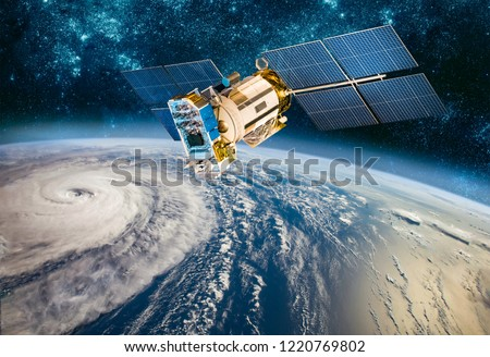 Space satellite monitoring from earth orbit weather from space, hurricane, Typhoon on planet earth. Elements of this image furnished by NASA. Royalty-Free Stock Photo #1220769802