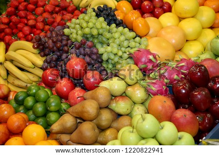 Background from freshly picked apples, pears, bananas, grapes, strawberries, cranberries, lemons, melons, raspberries, currants, blackberries, peaches, gooseberries, apricots, peaches #1220822941