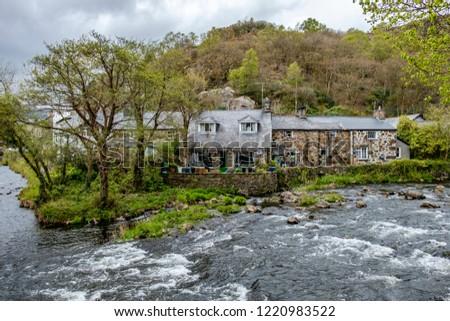 Glaslyn river running through Beddgelert valley in the heart of Smowdonia National Park in Gwynedd, Wales, UK #1220983522