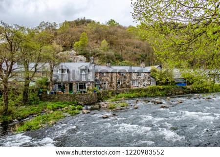 Glaslyn river running through Beddgelert valley in the heart of Smowdonia National Park in Gwynedd, Wales, UK #1220983552