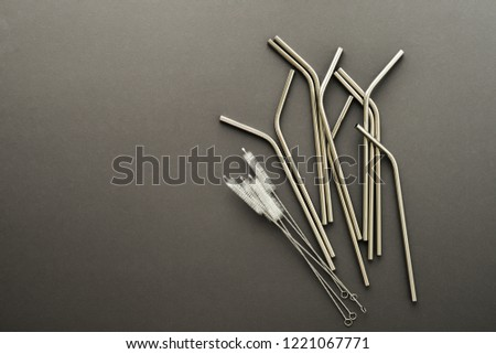 metal straw on gray background. flat lay top view. zero waste concept #1221067771