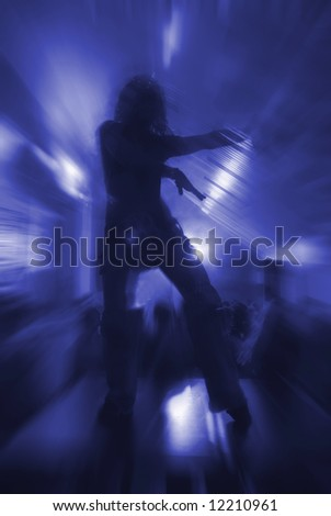 Silhouette of dancing woman at the party #12210961