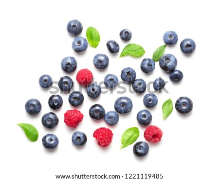 heap of assorted berries isolated on white background Royalty-Free Stock Photo #1221119485