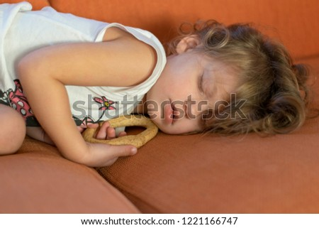 cute little girl, taking a nap on the couch  #1221166747