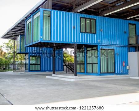 Modern blue cutting-edge shipping container construction office building. Royalty-Free Stock Photo #1221257680