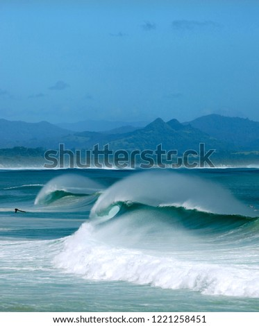Byron Bay, Australia. Pictured is The Wreck surf break, Belongil Beach, Byron Bay. The town on the most Easterly point of Australia is a mecca for the young, and young at heart.