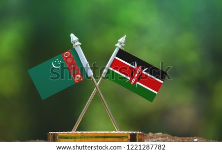 Kenya and Turkmenistan small flag with blur green background #1221287782