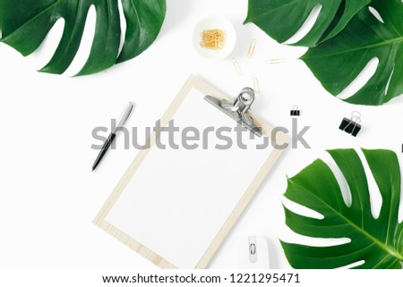 Clipboard with monstera leaves on white background flat lay, top view #1221295471