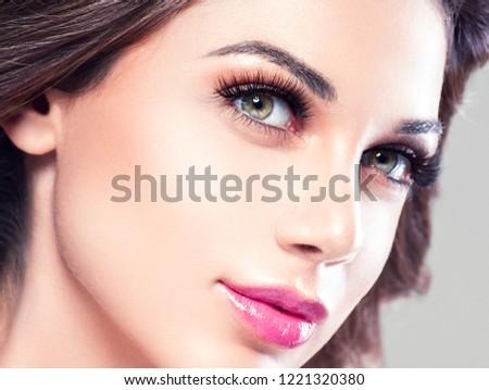 Beautiful woman eyes lips face with makeup healthy and beautiful closeup #1221320380