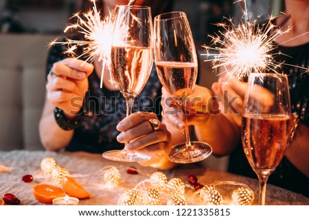 Friends celebrating Christmas or New Year eve party with Bengal lights and rose champagne. #1221335815